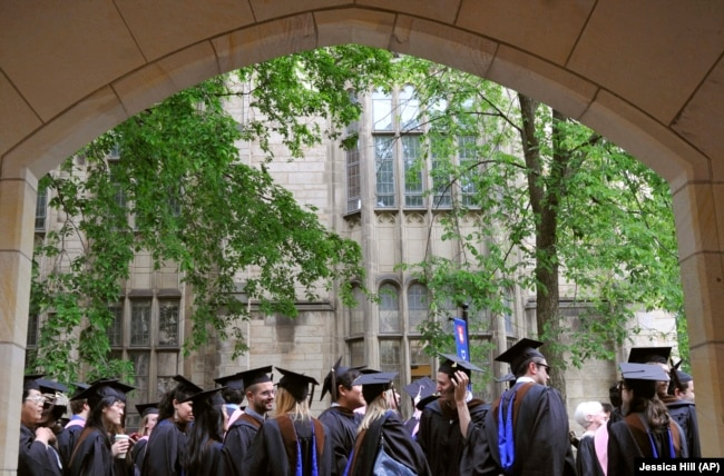 In this May 24, 2010 file photo, future graduates wait for the procession to begin for the graduation ceremony at Yale University in New Haven, Connecticut.