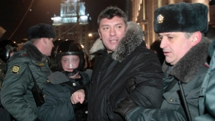 Riot police officers detain Russian opposition leader Boris Nemtsov during a rally in central Moscow, Russia, Friday, Dec. 31, 2010. Opposition groups have been calling rallies on the 31st day of each month to honor the 31st article of the Russian Constit