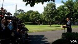 El presidente Barack Obama habla ante los medios en los Jardines de la Casa Blanca antes de partir a la Cumbre del G20.