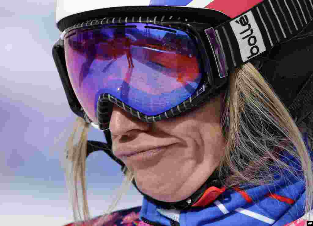 France's Deborah Anthonioz reacts after her seeding run during women's snowboard cross competition at the Rosa Khutor Extreme Park, at the 2014 Winter Olympics, Krasnaya Polyana, Russia, Feb. 16, 2014.