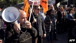 Public sector employees demonstrate in central Athens on November 13, 2012 against expected layoffs