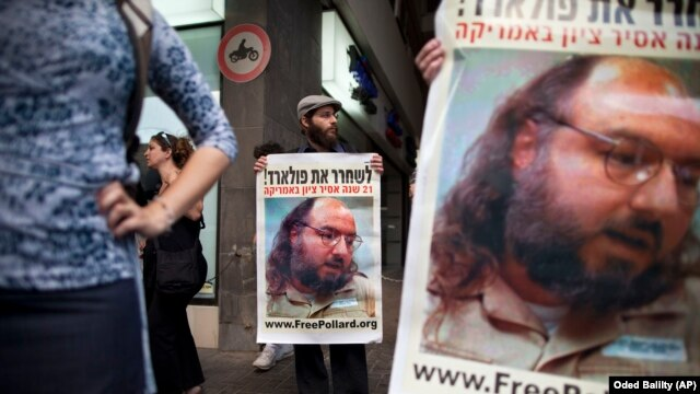 Israeli protesters hold posters demanding the release of Jonathan Pollard, a Jewish American who was jailed for life in 1987 on charges of spying on the United States, as they stand outside the U.S. embassy, Tel Aviv, Israel, June 19, 2011.