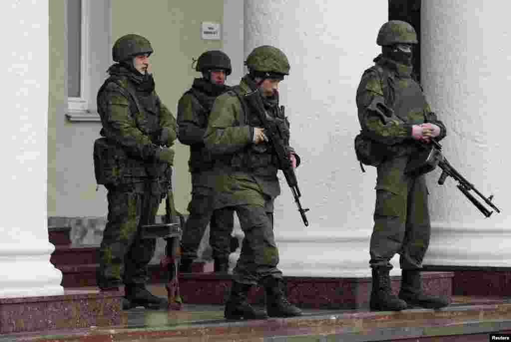 Armed men stand guard at the Simferopol airport in the Crimea region of Ukraine, Feb. 28, 2014.