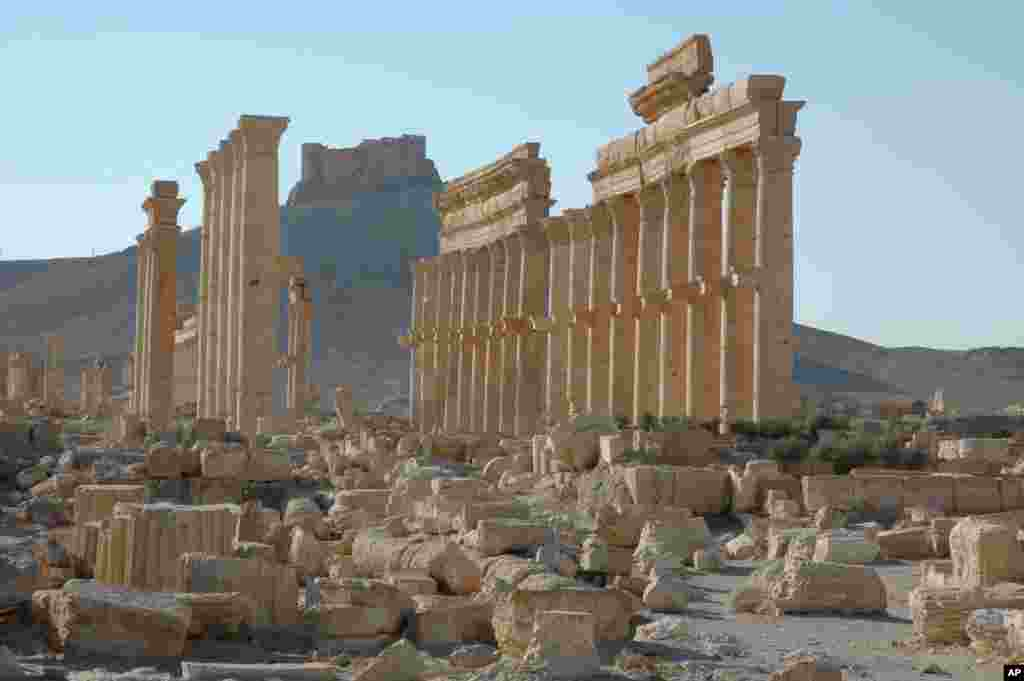 FILE - This undated file image released by UNESCO shows the site of the ancient city of Palmyra in Syria.