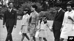 The Thailand Royal Family walks through the gardens of their residence at Sunninghill, Berkshire, United Kingdom on July 27, 1966 where they are staying during their private visit to Britain.