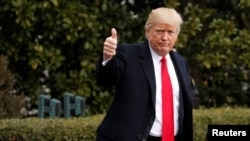 FILE - U.S. President Donald Trump gives a thumbs up as he departs the White House in Washington to spend the weekend in Florida, Feb. 3, 2017.