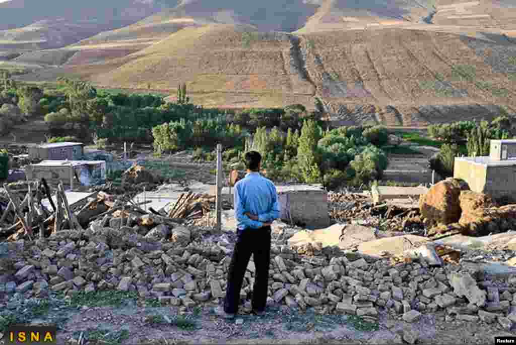 A man looks at damaged houses in the earthquake-stricken village of Varzaqan near Ahar, in East Azerbaijan province, August 12, 2012.