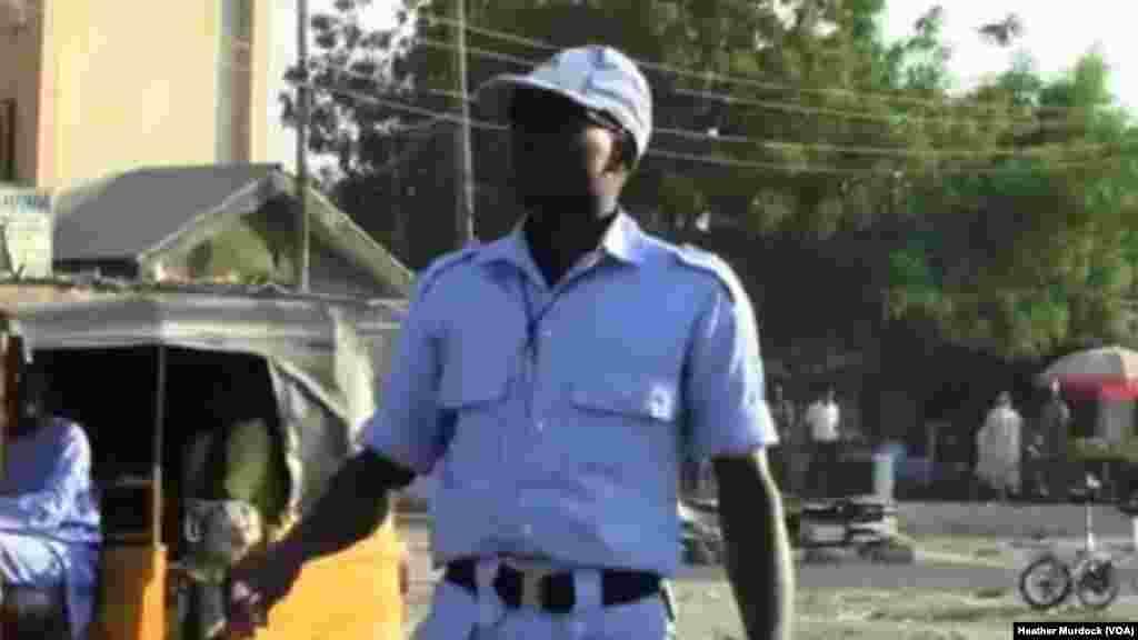A member of the Civilian JTF on watch, Maiduguri, Nigeria, December 2013