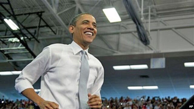 President Barack Obama arrives to speak at Florida Atlantic University in Boca Raton, Florida, April 10, 2012.