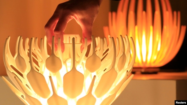 A 3D table lamp called the Lotus.MGX, designed by Janne Kyttanen, is seen at the Belgian company Materialise, the biggest 3D printer in Europe, in Leuven, January 24, 2013.