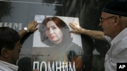 Poster with a photo of Natalya Estemirova, a human rights activist, on a base of a monument to killed journalists in the Chechen capital. (File)
