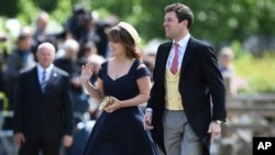 FILE - In this May 20, 2017 file photo, Britain's Princess Eugenie and her partner Jack Brooksbank arrive for the wedding of Pippa Middleton and James Matthews at St Mark's Church in Englefield, England.