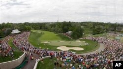 View from the newly built clock tower shows Tiger Woods putting on the 18th hole during the final round of the Memorial golf tournament, Dublin, Ohio, June 2, 2013.