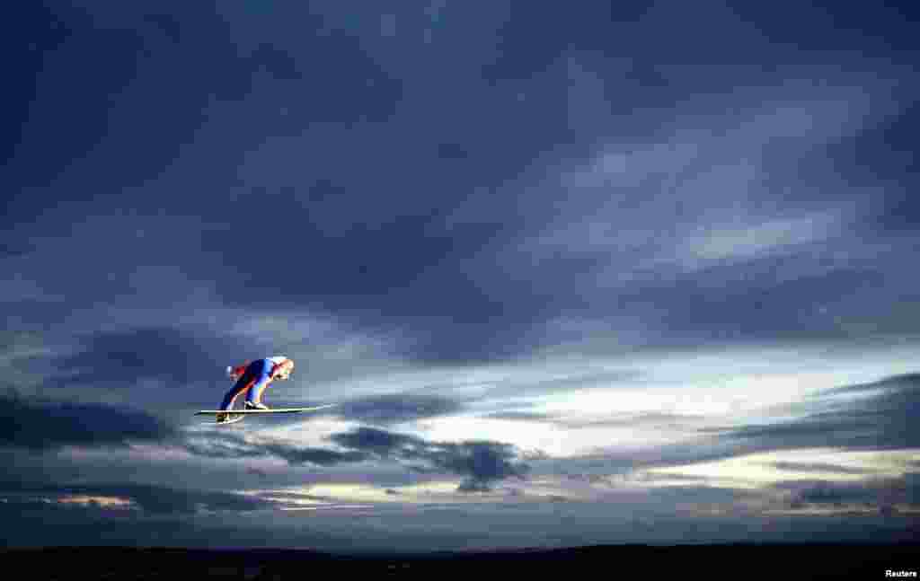 Stefan Kraft of Austria soars through the air during the men's large hill team ski jumping final at the Nordic World Ski Championships in Falun, Sweden, Feb. 28, 2015.