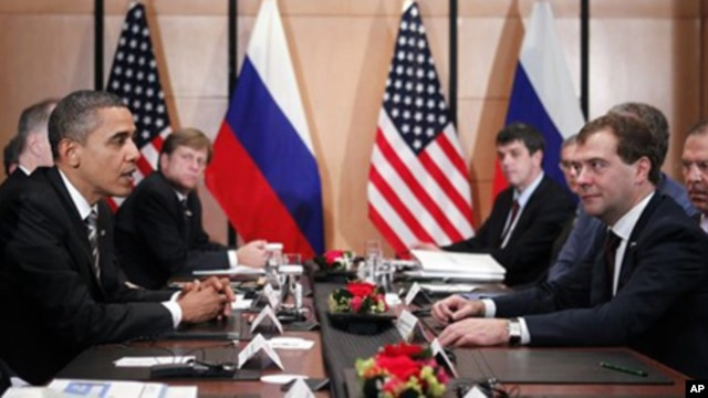 President Barack Obama meets with President Dmitry Medvedev of Russia on the sidelines of the APEC summit in Yokohama,  Japan, Sunday, Nov. 14, 2010.