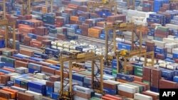 Containers are seen in a port in Singapore. There is $1.2 million in trade between the U.S. and the Asia-Pacific region.