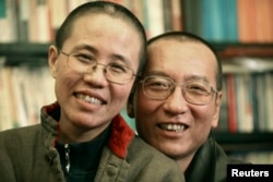 FILE - Chinese dissident Liu Xiaobo and his wife, Liu Xia, pose in this undated photo released by his family on Oct. 3, 2010.
