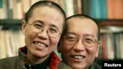 FILE - Chinese dissident Liu Xiaobo and his wife Liu Xia pose in this undated photo released by his family.