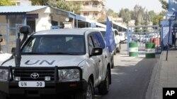 26일 시리아 수도 다마스쿠에서 유엔 휴전감시단을 태운 차량.