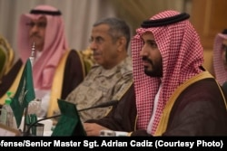 FILE - Saudi Arabia's Deputy Crown Prince and Minister of Defense Mohammed bin Salman, right, meets with Secretary of Defense Ash Carter, not shown, in Riyadh, Saudi Arabia, April 19, 2016.