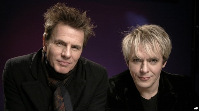 Recording artists John Taylor, left, and Nick Rhodes of the band Duran Duran pose for a portrait, Wednesday, March 30, 2011 in New York.