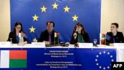 Members of the European Union Election Observation Mission in Madagascar, Peggy Corlin (L), Philippe Boulland (2nd L), Maria Muniz de Urquiza (2nd R), and Sandrine Espinoza, speak to journalists during a press conference concerning election results in Ant