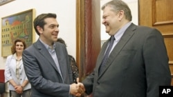 Socialist PASOK party leader Evangelos Venizelos (R) and Greece's Left Coalition party head Alexis Tsipras shake hands during their meeting at the parliament in Athens, May 11, 2012.