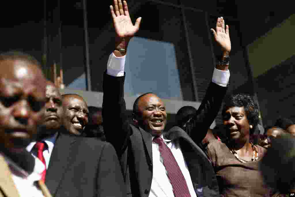 Kenyan president-elect Uhuru Kenyatta waves at supporters after winning the elections in Nairobi, Mar. 9, 2013.