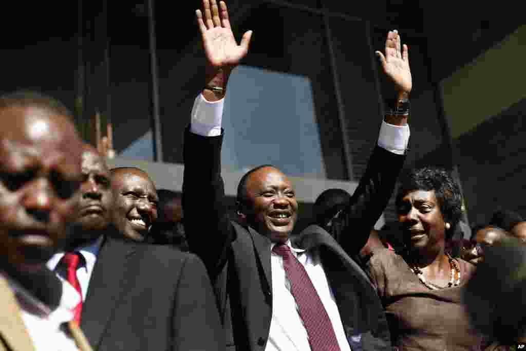 Kenyan president-elect Uhuru Kenyatta waves at supporters after winning the elections in Nairobi, Mar. 9, 2013.