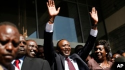 Kenyan president elect Uhuru Kenyatta waves at supporters after winning the elections in Nairobi, Mar. 9, 2013. Kenya's election commission posted complete results early Saturday showing that Deputy Prime Minister Uhuru Kenyatta prevailed in the country'