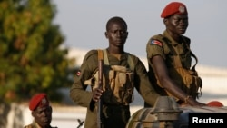 FILE - SPLA soldiers stand in a vehicle in Juba, Dec. 20, 2013. The Sudan People's Liberation Army is accused of attacking civilians over the weekend. A spokesman denies the allegations.