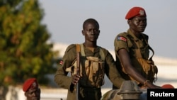 SPLA soldiers stand in a vehicle in Juba days after clashes erupted in December. Fresh fighting at the headquarters of SPLA ground forces triggered panic among Juba residents Wednesday.