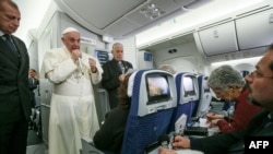 Pope Francis speaks to journalists aboard the flight from Mexico to Italy, Feb. 18, 2016.