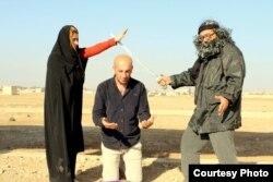 The Arta FM staff performs a mock IS-style execution. (Courtesy - Arta FM)