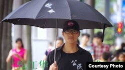 三名中国公民记者之一、广东人权活动人士甄江华 (资料照片)