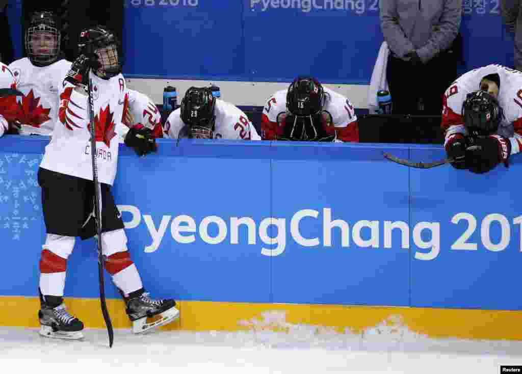 Team Canada players react on the bench at the end of the women's gold medal hockey game in Gangneung, South Korea, Feb. 22, 2018.