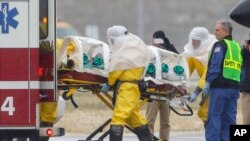 File - Health care worker, possibly exposed to the Ebola virus, is being transported to a hospital in Omaha, Nebraska