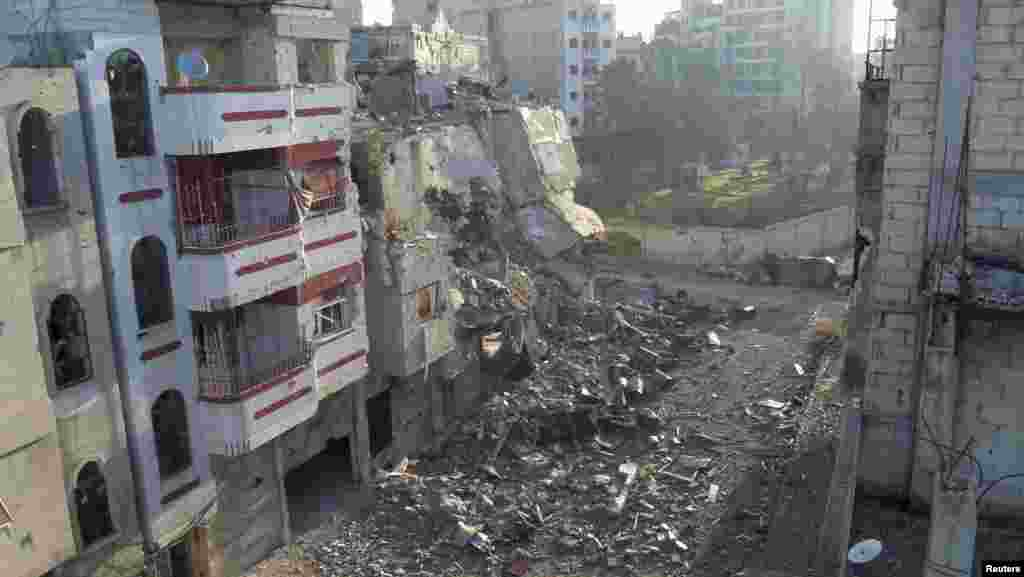 Damaged buildings are seen in Al-Khalidiya neighborhood of Homs, Syria, December 16, 2012.
