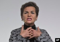 """U.N. climate chief Christiana Figueres speaks during the """"Action Day"""", at the COP21, United Nations Climate Change Conference, in Le Bourget north of Paris, France, Dec. 5, 2015."""