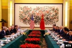 U.S. Commerce Secretary Wilbur Ross, second from left, and Chinese Vice Premier Liu He, fourth right, attend a meeting at the Diaoyutai State Guesthouse in Beijing, June 3, 2018.
