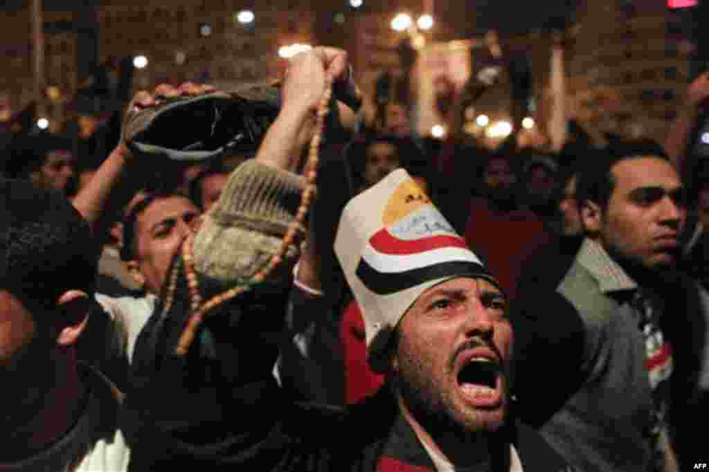 Anti-government protesters react to Egyptian President Hosni Mubarak's televised statement to his nation in Tahrir Square in downtown Cairo, Egypt Thursday, Feb. 10, 2011. Egyptian President Hosni Mubarak announced he is handing his powers over to his vi