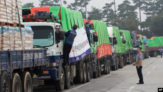 FILE - South Korean trucks with food aid prepare to leave for the North Korean city of Kaesong in Paju, South Korea, Sept. 21, 2012.