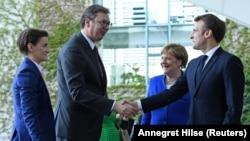 Nemačka kancelarka Angela Merkel i predsednik Francuske Emanuel Makron dočekuju predsednika i premijerku Srbije Aleksandra Vučića i Anu Brnabić u Berlinu (Foto: Reuters/Annegret Hilse)