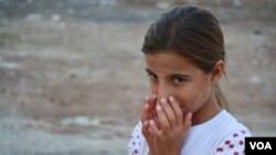 Near Turkey's border with Syria, many refugees in camps are eager to try to get to Europe. But some families, like that of 11-year-old Maryam, say after years of war, they prefer the small comforts of the camps. (Credit: Heather Murdock/VOA)