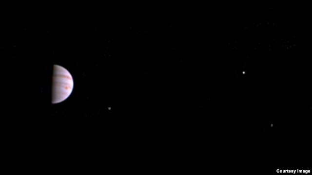 Us First Space Probe : Us space probe sends first picture of jupiter from orbit