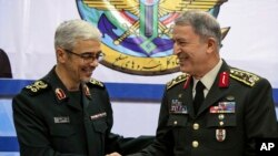 Turkey's Chief of Staff Gen. Hulusi Akar (R) and Iran's Chief of Staff of Armed Forces, Gen. Mohammad Hossein Bagheri, shake hands after a meeting in Tehran, Iran, Oct. 2, 2017.
