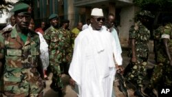 FILE - Gambian President Yahya Jammeh, center, leaves a central Banjul polling station in Banjul, Gambia, Sept. 22, 2006.