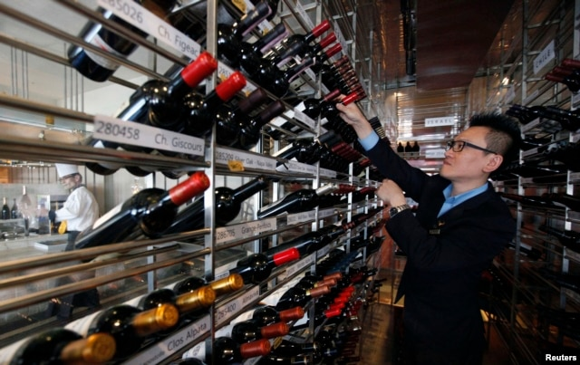 A manager looks at wines at the Marco Polo restaurant at the Grand Intercontinental Hotel in the Gangnam area of Seoul, South Korea, Oct. 2, 2012.