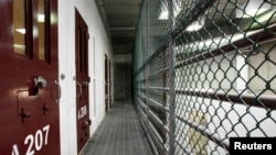 FILE - The interior of an unoccupied communal cell block is seen at Camp VI, a prison used to house detainees at the U.S. Naval Base at Guantanamo Bay on March 5, 2013.