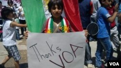 A Syrian Kurdish child at a protest rally holds a poster thanking Voice of America's Kurdish Service for its coverage of the uprising in Syria.